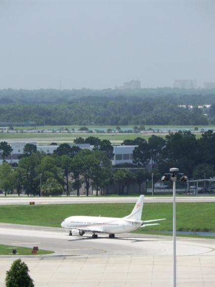 Aircraft with Downtown Orlando Behind