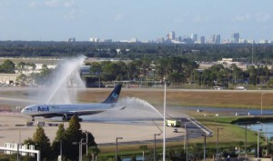 The Orlando skyline can be seen in the background as the first Azul flight from Belo Horizonte arrives at Orlando International Airport to a water salute from Airport Rescue Fire Fighters