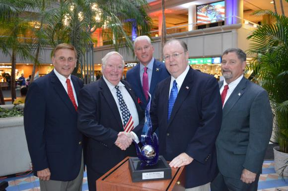 Congressman John Mica, Col. Joe Kittinger, GOAA Vice Chairman Dean Asher, GOAA Chairman Frank Kruppenbacher and GOAA Executive Director Phil Brown with this year's specially designed Kittinger Award.